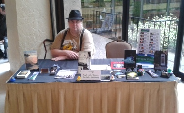 Jeffrey Cook at the Maple Valley Writers/FreeValley Publishing Norwescon Table  -photo by Rachel Barnard